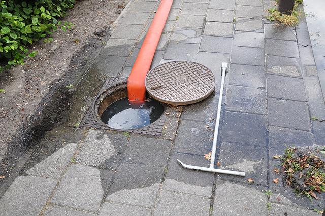 Uncovered manhole