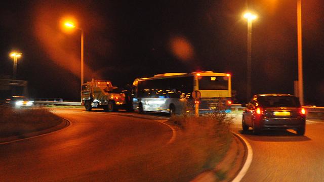Broken-down bus on tow