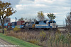 electro_motive_csx_stack_train_along_us30_in_il_10'11