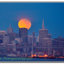 Penumbral lunar eclipse over San Francisco skyline