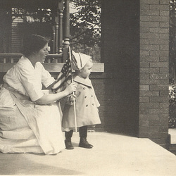 My dad with his mother, patriotically showing the colors from the front porch shortly after the U.S. entered the Great War, 1917