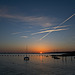 Sunset and vapour trails