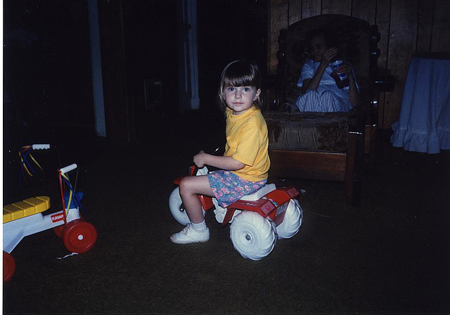Kristin on Alex's tricycle.BMP
