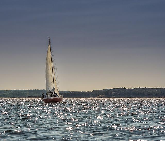 Under sail.