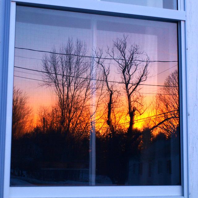 sunrise reflected in my window