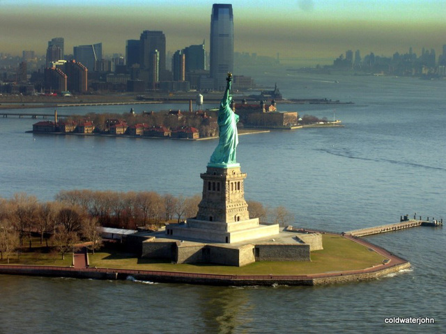 Statue of Liberty at dawn in March - aerial
