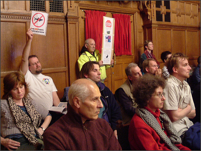 worried  audience at the town hall