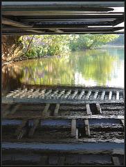 reflections beneath a bridge