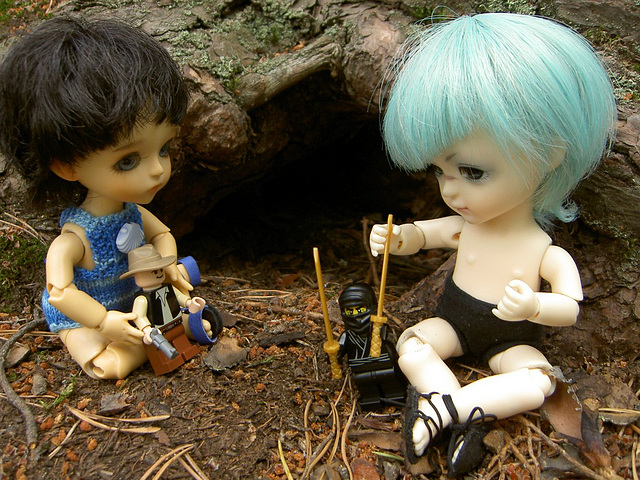 Algol and Spark playing with action figures