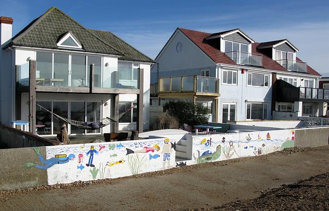 Decorated sea wall - icanseethesea