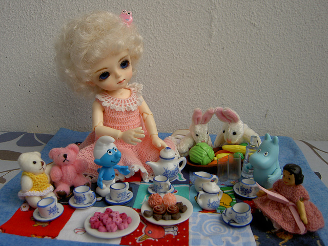 Pilvi having a tea party with her dollies and stuffies