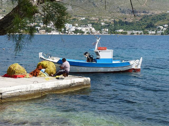 Alinda- Fisherman, Nets and Boat