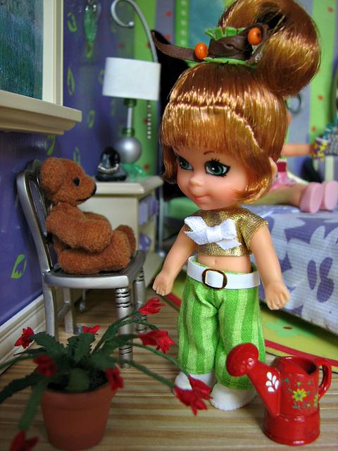 Henrietta contemplates the Christmas Cactus.