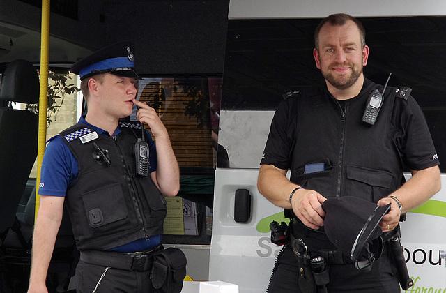 She's got a camera, shall we arrest her sarge?