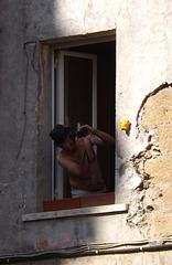 Man in a Window in the Building Facing the Piazza della Scala in Trastevere, June 2012