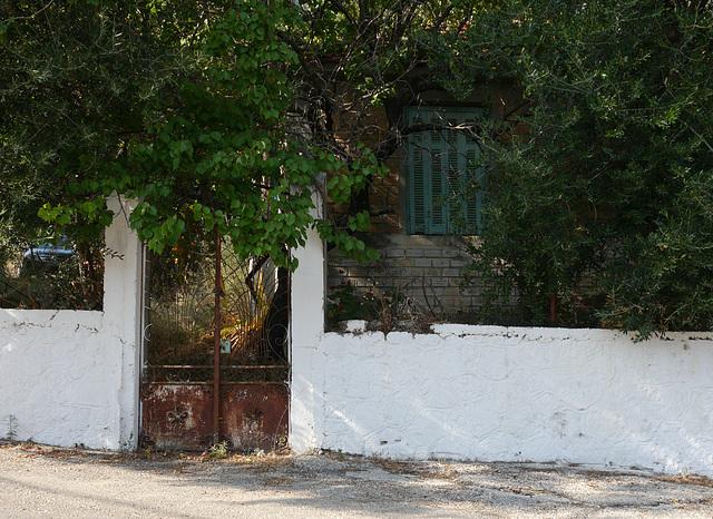 gate, window, white-washed wall