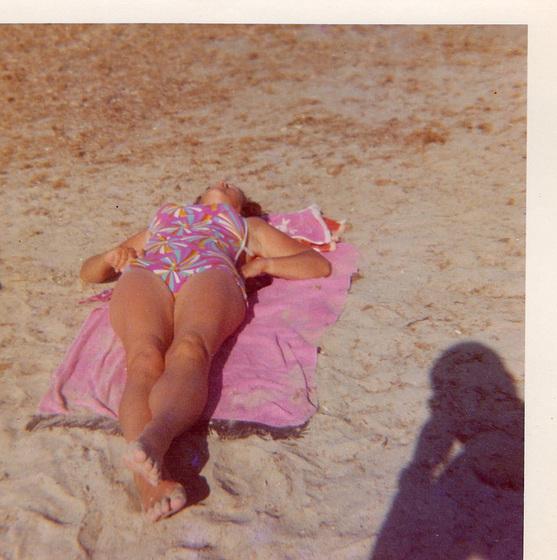 My mum horizontal on the beach