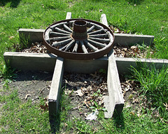 Wheel Outside of the Bach Blacksmith Shop in Old Bethpage Village Restoration, May 2007