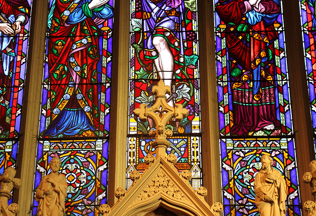 Altar decoration and stained glass window in St Peter and St Paul Church, Lavenham, Suffolk, England