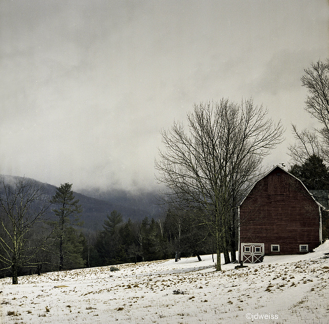 winter scene with red barn