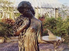 Bronze Sculpture of a Girl Holding a Sundial in the Rose Garden of the Brooklyn Botanic Garden, Nov. 2006