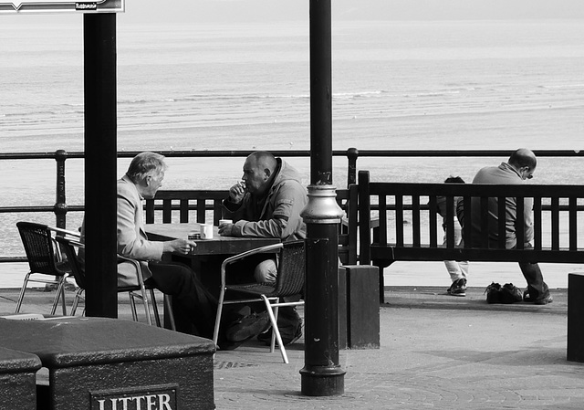 People in conversation at Filey