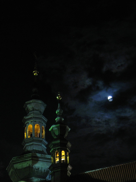 A glimpse of the moon over Strahov Monastery