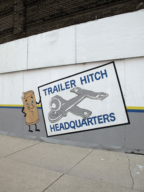 A nonstop-jibber-jabbering muffler bears a giant posterboard picture of some kind of aircraft prototype.