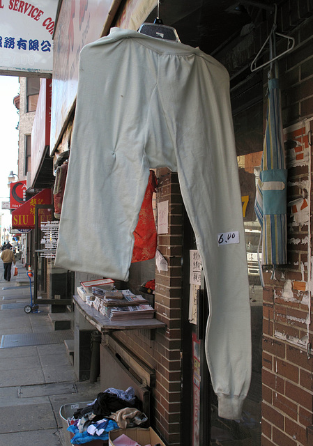 A $6 garment, hanging on a hanger.