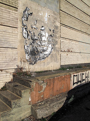 ~½ a pasteup of a cinderblocked entry.