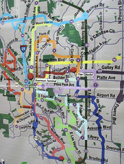 Colorado Springs transit system maps, very fatly-lined hamhandedness of busroutes art in random crayon colours.