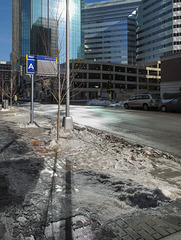 Wet mess of sidewalk among double sunniness of downtown Minneapolis.