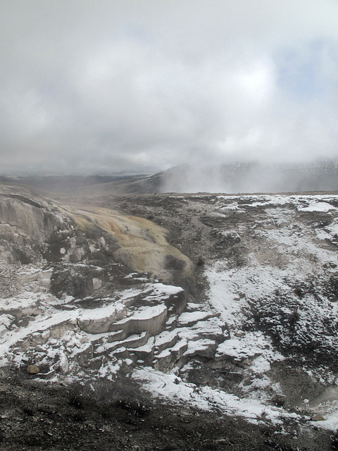 This morning the sleeping snow-covered terraces of travertine are being tickled awake by drifting clouds of sulfur-scented steam.