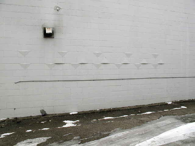 Just exactly enough of the modernism decorations on the cinderblock wall.  Just small gentle touches' worth of them.