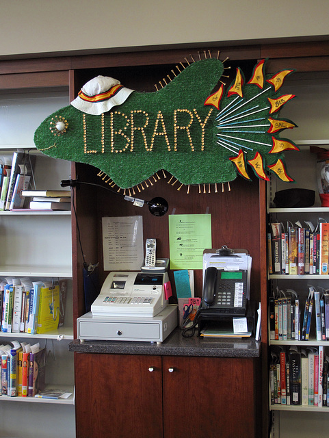 A golf-themed library fish of outdoor carpeting.