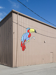 "The famous metal ""Toucan Golf"" building of downtown Mansfield, Ohio, with its small ""golfing toucan"" picture on the outside."