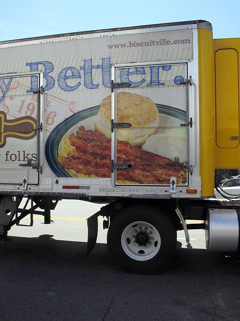 Noise & exhaust of barrelling semi trailerload of bacon strips & scrambled eggs with buttered grits & buttered biscuit.