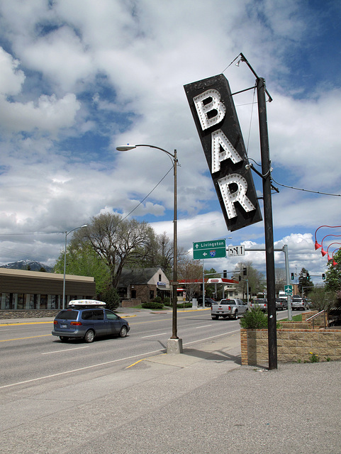 """For Bozeman motorists, tippiness of sign orientation is the invitation to tipsiness.  Says, """"People, get out of your goddamned cars for once and come in here and drink and drink!"""""""