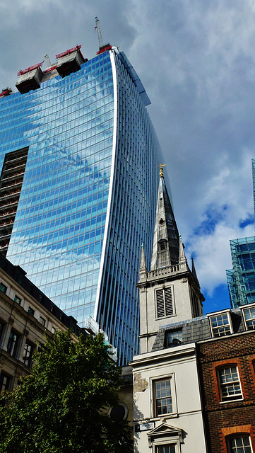 the walkie talkie looming over the spire of wren's st.margaret pattens, london