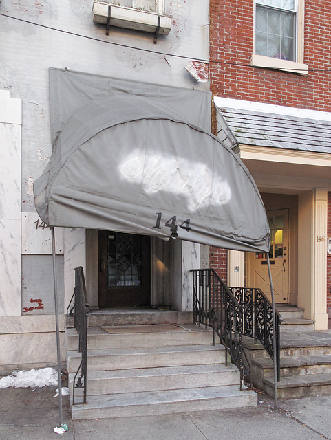 """Old busted & exhausted painted-over """"Marilyn"""" canopy of downtown Reading Pa."""