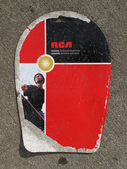 "Product of the year!  RCA ""foldable neckband headphones"" / ""plegable neckband auriculares,"" sidewalk litter."