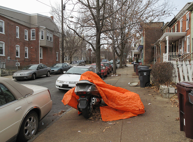 An orange motorcycle!, in an area of Wilmington Delaware residential.