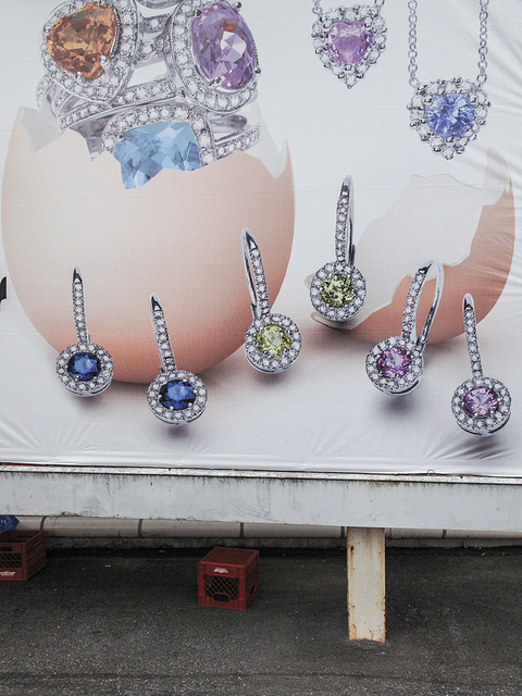 Billboard advertising idea of digging colourful gemstones out of the wet insides of poultry eggs.