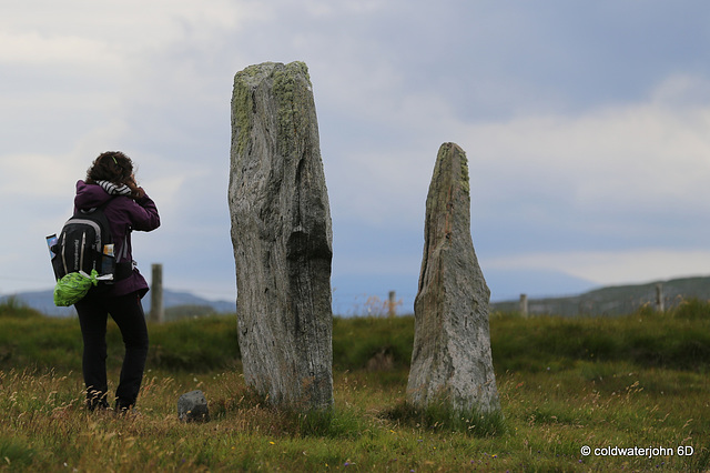 Visitor sizing up one of the stones in Callanish Stone Circle #2