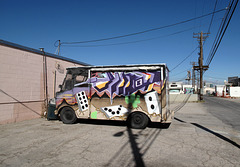 Las Vegas backalley delivery!  A truck idea of purple geometry ideas, white dominoes, cactus.