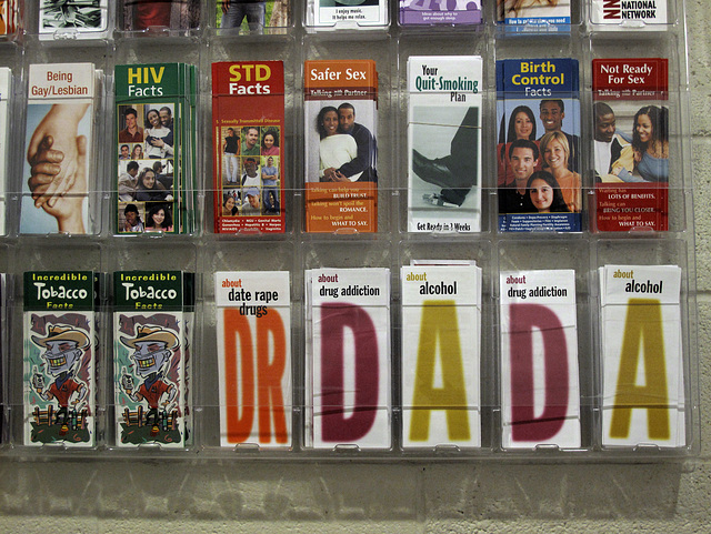 """""""Dr. Dada"""" arrangement of difficult health & social issues pamphlets rack."""