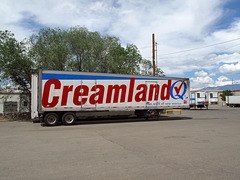 """Creamland: The Milk of New Mexico,"" industrial trailerloads of creamy gallons of milk feast."