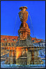 BESANCON: Levé du soleil sur la fontaine de la  place du marché.
