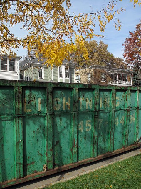 A picture of a green Lightning Dumpster.