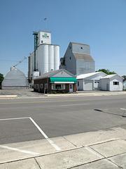 "The lordingly towering ""Walton Agri-Service, Inc."" grain elevators of downtown Upper Sandusky, Ohio, and adjacent bldgs."